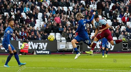 Pablo Fornals of West Ham (R)gets ahead of Tom Davies of Everton to get good contact on a header before Goalkeeper Jordan Pickford of Everton pulls off a great save flicking the ball over the bar on the stroke of half time.
