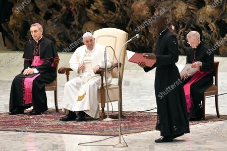 Pope Francis talks with Papal Household Archbishop Georg Ganswein during his weekly general audience, in Paul VI Hall at the Vatican