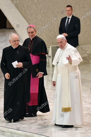Pope Francis talks with Papal Household Archbishop Georg Ganswein and Leonardo Sapienza during his weekly general audience, in Paul VI Hall at the Vatican