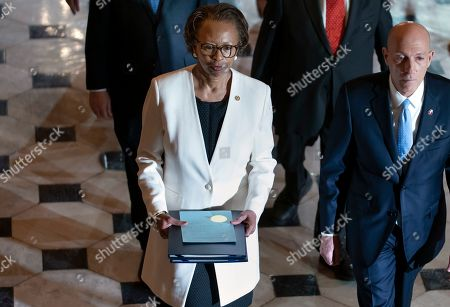 Paul Irving, Cheryl Johnson. Clerk of the House Cheryl Johnson, left, and House Sergeant at Arms Paul Irving pass through Statuary Hall at the Capitol to deliver the articles of impeachment against President Donald Trump to the Senate, on Capitol Hill in Washington