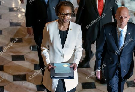 Paul Irving, Cheryl Johnson. Clerk of the House Cheryl Johnson, center, with House Sergeant at Arms Paul Irving, right, pass through Statuary Hall at the Capitol to deliver the articles of impeachment against President Donald Trump to the Senate, on Capitol Hill in Washington