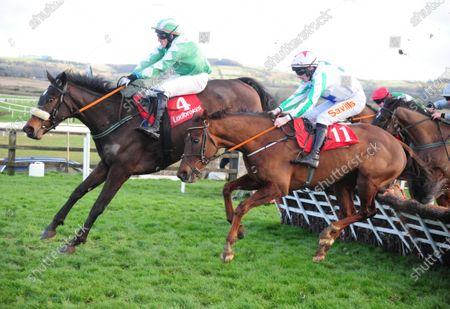 PUNCHESTOWN KEY COMMANDER and Barry John Foley (far) wins the Ladbrokes Novice Handicap Hurdle as Cousin Harry and Sean Flanagan (near) come down. Both horse and rider were ok. Healy Racing