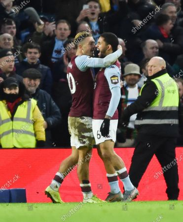 Jack Grealish of Aston Villa (left) celebrates scoring with Douglas Luiz during the Premier League match between Brighton and Hove Albion and Aston Villa at The Amex Stadium Brighton, UK - 18th January 2020