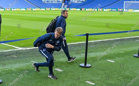 Brighton head coach Graham Potter ducks under the tape as he arrives with assistant Billy Reid  for the Premier League match between Brighton and Hove Albion and Aston Villa at The Amex Stadium Brighton, UK - 18th January 2020