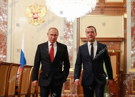 Russian President Vladimir Putin (L) and  Russian Prime Minister Dmitry Medvedev (R) prior to a meeting with Cabinet members at the Government's headquarters in Moscow, Russia, 15 January 2020. Russian Prime Minister Dmitry Medvedev announced of resignation of Russian Government.