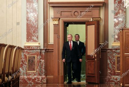 Russian President Vladimir Putin (L) and  Russian Prime Minister Dmitry Medvedev (R) enter a hall prior to a meeting with Cabinet members at the Government's headquarters in Moscow, Russia, 15 January 2020. Russian Prime Minister Dmitry Medvedev announced of resignation of Russian Government.