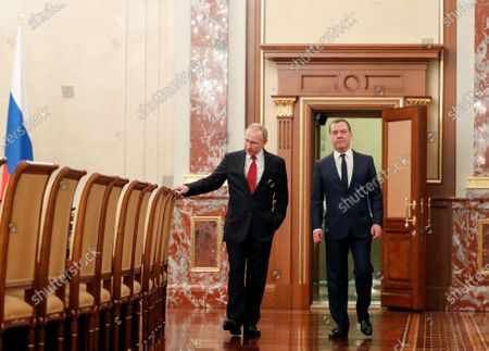 Russian President Vladimir Putin (L) and  Russian Prime Minister Dmitry Medvedev (R) enter a hall prior to a meeting with Cabinet members at the Government's headquarters in Moscow, Russia, 15 January 2020. Russian Prime Minister Dmitry Medvedev announced the resignation of the Russian Government.