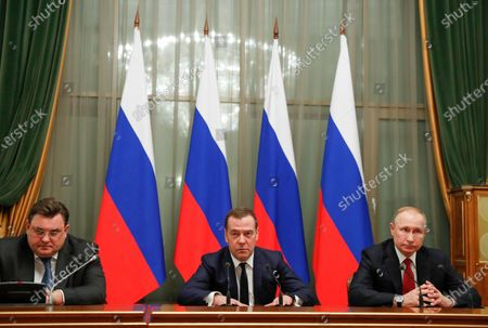 Russian President Vladimir Putin (R),  Russian Prime Minister Dmitry Medvedev (C) and Chief of Staff of the Russian Government Konstantin Chuichenko (L) attend a meeting with Cabinet members at the Government's headquarters in Moscow, Russia, 15 January 2020. Russian Prime Minister Dmitry Medvedev announced the resignation of the Russian Government.