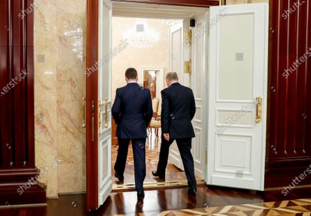 Russian President Vladimir Putin (R, back to camera) and Russian Prime Minister Dmitry Medvedev (L, back to camera) leave after a meeting with Cabinet members at the Government's headquarters in Moscow, Russia, 15 January 2020. Russian Prime Minister Dmitry Medvedev announced the resignation of the Russian Government.