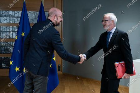 European Investment Bank (EIB) President Werner Hoyer shakes hands with European Council President Charles Michel before their meeting at the Europa building in Brussels, Belgium, 15 January 2020.
