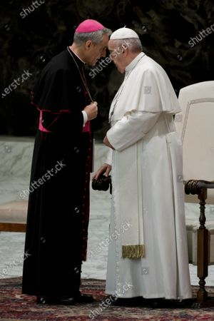 Stock Image of Archbishop Georg Ganswein (L), Prefect of the Papal Household, talks with Pope Francis during the weekly General Audience in Paul VI Hall.