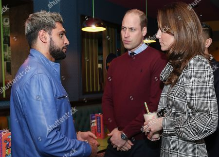 Prince William and Catherine Duchess of Cambridge meet with Amir Khan during a visit to MyLahores flagship restaurant on January 15, 2020 in Bradford, United Kingdom. MyLahore is a British Asian restaurant chain which has taken inspiration from Lahore, the Food Capital of Pakistan. The Duke and Duchess visited Lahore during their recent tour to Pakistan.