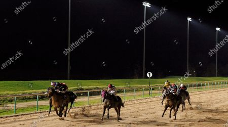 RED STRIPES (centre, Charles Bishop) wins The Betway Heed Your Hunch Handicap Southwell