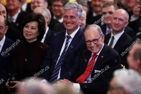 "Elaine Chao, Robert O'Brien, Larry Kudlow. Secretary of Transportation Elaine Chao, center, national security adviser Robert O'Brien, and White House Chief economic adviser Larry Kudlow, right, share a laugh during a ceremony ceremony for the ""phase one"" of a US China trade agreement, in the East Room of the White House, in Washington"