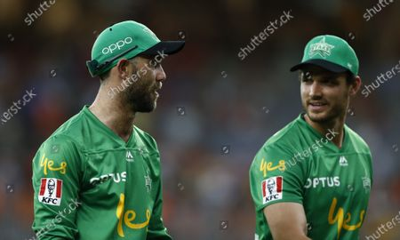 Stock Picture of Glenn Maxwell walks off the field with Nathan Coulter-Nile of the Melbourne Stars