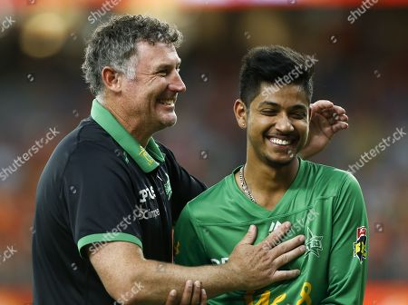 Stock Picture of Melbourne coach David Hussey jokes with Sandeep Lamichhane as the walk off the field