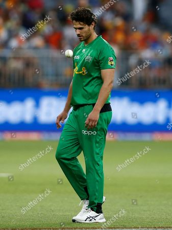 Nathan Coulter-Nile of the Melbourne Stars walks back to bowling mark