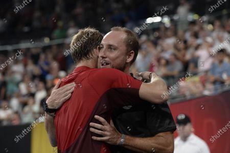 Steve Darcis captain of Team Belgium congratulates David Goffin of Belgium