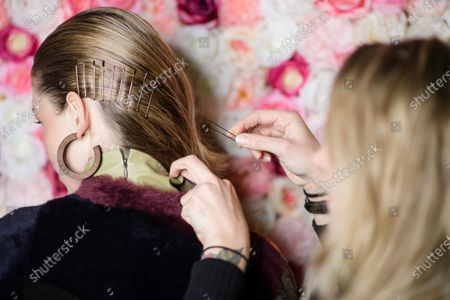 A model receives hair clips during backstage preparations prior to the Dawid Tomaszewski show during the Berlin Fashion Week, in Berlin, Germany, 15 January 2020. The Fall/Winter 2020 collections are presented at the Berlin Fashion Week from 13 to 17 January.