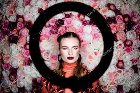 A model poses for a photographer behind a ring light during backstage preparations prior to the Dawid Tomaszewski show during the Berlin Fashion Week, in Berlin, Germany, 15 January 2020. The Fall/Winter 2020 collections are presented at the Berlin Fashion Week from 13 to 17 January.