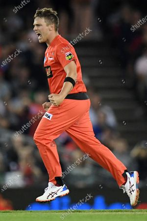 Cameron Boyce of the Renegades celebrates a wicket