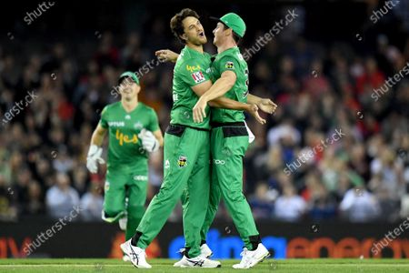 Nathan Coulter-Nile and Hilton Cartwright of the Stars celebrate the wicket of Marcus Harris of the Renegades
