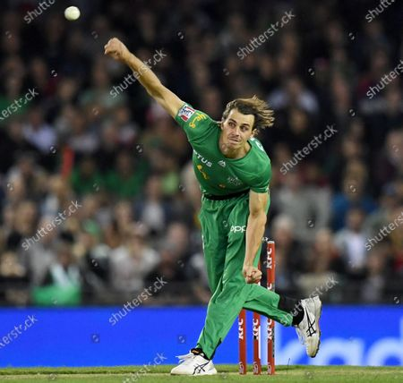 Stock Photo of Nathan Coulter-Nile of the Stars bowls the ball