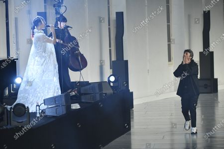 Singer FKA Twiggs (L) performs during the presentation of creations from the Fall/ Winter 2020/2021 Ready to Wear collection by Italian designer Pierpaolo Piccioli (R) for Valentino fashion house during the Paris Fashion Week, in Paris, France, 15 January 2020. The presentation of the men's collections runs from 14 to 19 January.