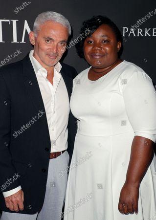 Stock Image of Frank Giustra and Sergeline Rene