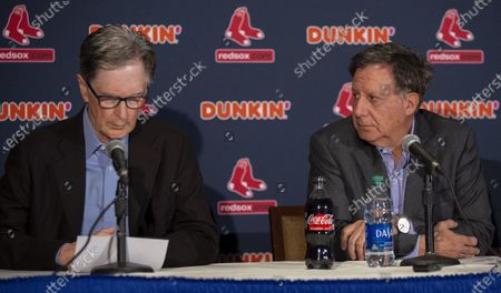 Boston Red Sox Chairman Tom Werner (2L) listens as Principal Owner John Henry (L) reads a statement to the media regarding the sign stealing cheating scandal, during a news conference at Fenway Park in Boston, Massachusetts, USA 15 January 2020.