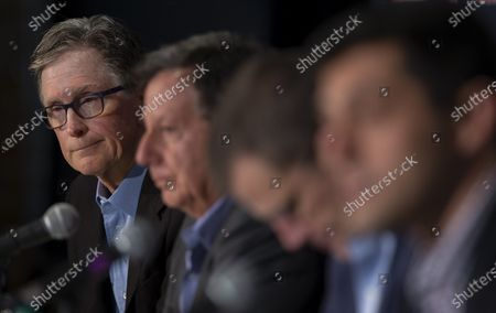 Boston Red Sox Principal Owner John Henry (L) pauses to listen while sitting with Chairman Tom Werner (2L) President and CEO Sam Kennedy (2R)  and Chief Baseball Officer Chaim Bloom (R) during a news conference regarding the sign stealing cheating scandal, at Fenway Park in Boston, Massachusetts, USA 15 January 2020.