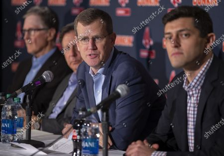 Stock Image of Boston Red Sox President and CEO Sam Kennedy (2R) answers a question during a news conference regarding the sign stealing cheating scandal, as Principal Owner John Henry (L) Chairman Tom Werner (2L) and Chief Baseball Officer Chaim Bloom (R) listen in, during a news conference at Fenway Park in Boston, Massachusetts, USA 15 January 2020.