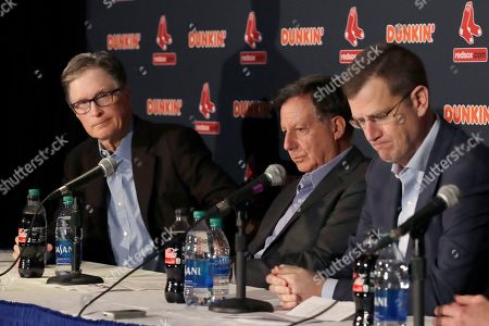 Stock Picture of John Henry, Tom Werner, Sam Kennedy. From left, Boston Red Sox owner John Henry, chairman Tom Werner and CEO Sam Kennedy react during a news conference at Fenway Park, in Boston. The Boston Red Sox have parted ways with manager Alex Cora, with the move coming one day after baseball Commissioner Rob Manfred named him as a ringleader with Houston in the sport's sign-stealing scandal