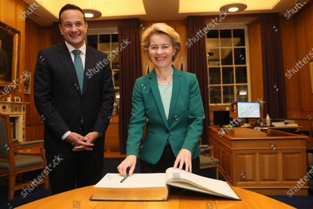 Stock Picture of European Commission President Ursula von der Leyen (R) signing the visitors book as Taoiseach Leo Varadkar welcomes her to Government Buildings, Dublin, Ireland, 15 January 2020.