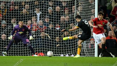 Stock Image of Raul Jimenez (2R) of Wolverhampton attempts to score against goalkeeper Sergio Romero of Manchester United during the English FA Cup 3rd round replay match between Manchester United and Wolverhampton Wanderers in Manchester, Britain, 15 January 2020.