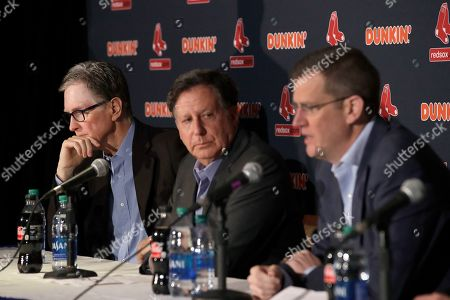From left, Boston Red Sox owner John Henry, chairman Tom Werner and CEO Sam Kennedy participate in a news conference at Fenway Park, in Boston. The Boston Red Sox have parted ways with manager Alex Cora, with the move coming one day after baseball Commissioner Rob Manfred named him as a ringleader with Houston in the sport's sign-stealing scandal