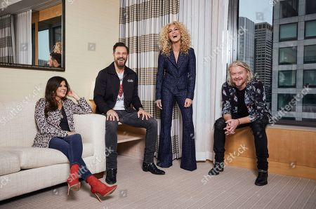 """Karen Fairchild, left, Jimi Westbrook, Kimberly Schlapman, Phillip Sweet. This photo shows members of the country group Little Big Town, from left, Karen Fairchild, Jimi Westbrook, Kimberly Schlapman and Phillip Sweet posing for a portrait in New York to promote their new album """"Nightfall,"""" out on Friday"""