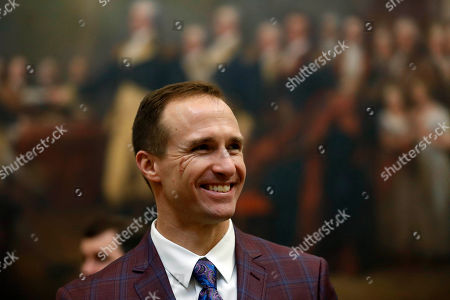 New Orleans Saints NFL football quarterback Drew Brees gets a tour of the rotunda at the Capitol, in Washington, before a Congressional Gold Medal ceremony for former NFL player Steve Gleason