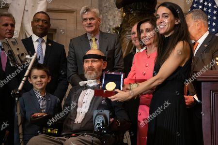 Steve Gleason, Michel Gleason. A Congressional Gold Medal is presented to amyotrophic lateral sclerosis (ALS) advocate and former National Football League (NFL) player, Steve Gleason, in Statuary Hall on Capitol Hill, in Washington. Holding the medal is his wife Michel Gleason