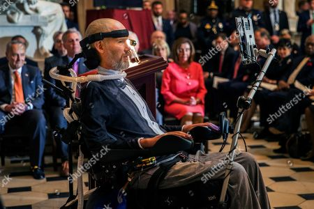 Steve Gleason, amyotrophic lateral sclerosis (ALS) advocate and former National Football League (NFL) player, delivers remarks after being presented with a Congressional Gold Medal during a ceremony honoring him in Statuary Hall at the Capitol Hill, in Washington