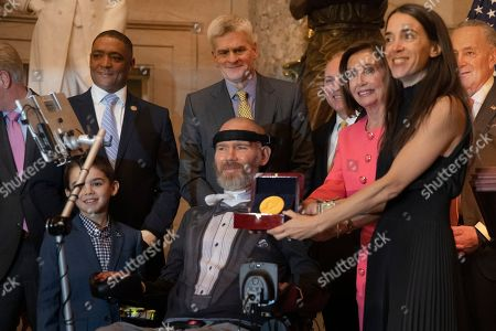 Michel Gleason. Nancy Pelosi, Steve Gleason. House Speaker Nancy Pelosi of Calif., presents a Congressional Gold Medal to presented to amyotrophic lateral sclerosis (ALS) advocate and former National Football League (NFL) player, Steve Gleason, in Statuary Hall on Capitol Hill, in Washington. Assisting Pelosi Gelason's wife Michel Gleason