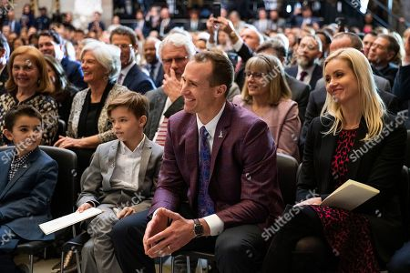 New Orleans Saints quarterback Drew Brees, reacts to the remarks from his former teammate, amyotrophic lateral sclerosis (ALS) advocate and former National Football League (NFL) player, Steve Gleason, during a ceremony honoring Gleason with Congressional Gold Medal in Statuary Hall on Capitol Hill, in Washington
