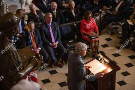 Nancy Pelosi, Mitch McConnell. Senate Majority Leader Mitch McConnell of Ky., together with House Speaker Nancy Pelosi and the Congressional leadership and other members of Congress, speaks during a Congressional Gold Medal ceremony honoring amyotrophic lateral sclerosis (ALS) advocate and former National Football League (NFL) player, Steve Gleason, in Statuary Hall on Capitol Hill, in Washington