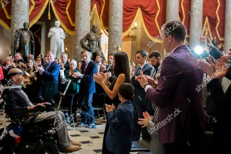 Drew Brees, Steve Gleason. New Orleans Saints quarterback Drew Brees, right, applauds his former teammate amyotrophic lateral sclerosis (ALS) advocate and former National Football League (NFL) player Steve Gleason, left, during a ceremony honoring Gleason with Congressional Gold Medal in Statuary Hall on Capitol Hill, in Washington