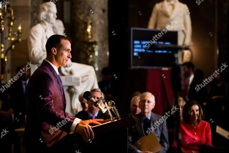 New Orleans Saints quarterback Drew Brees, with voice sometimes choking, speaks about his good friend and former teammate amyotrophic lateral sclerosis (ALS) advocate and former National Football League (NFL) player Steve Gleason, during a Congressional Gold Medal ceremony honoring Gleason, in Statuary Hall on Capitol Hill, in Washington