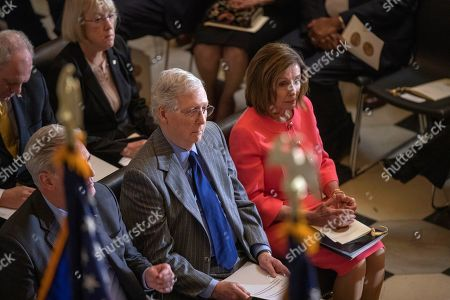 Nancy Pelosi, Mitch McConnell. House Speaker Nancy Pelosi and Senate Majority Leader Mitch McConnell of Ky., join Congressional leadership and other members of Congress at a Congressional Gold Medal ceremony honoring amyotrophic lateral sclerosis (ALS) advocate and former National Football League (NFL) player, Steve Gleason, in Statuary Hall on Capitol Hill, in Washington