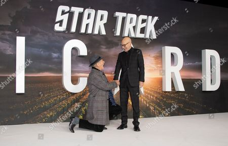 Patrick Stewart, Ian Mckellen. Actor Sir Ian Mckellen kneels at the feet of Sir Patrick Stewart, right, as they pose for photographers upon arrival at the premiere for 'Star Trek: Picard' in London