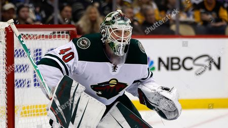 Minnesota Wild goaltender Devan Dubnyk plays during the second period of an NHL hockey game against the Pittsburgh Penguins in Pittsburgh