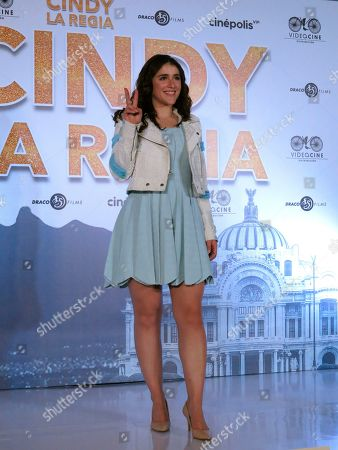 """Actress Cassandra Sanchez Navarro poses for photos during a press conference promoting the Mexican film """"Cindy la Regia"""" in Mexico City. The film premieres in Mexico on Jan. 24"""