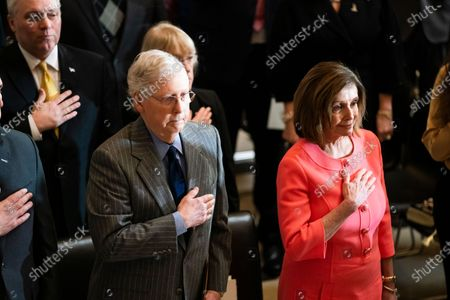 Speaker of the House Nancy Pelosi (R) and Senate Majority Leader Mitch McConnell (L) attend a Congressional gold medal ceremony in honor of retired football player and advocate for patients with Lou Gehrig's disease Steve Gleason in Statuary Hall in the US Capitol in Washington, DC, 15 January 2020. Later in the day, Pelosi will send the articles of impeachment against President Trump to the Senate for a trial.